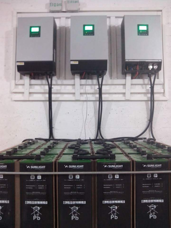Three single phase solar inverters with built in battery charger are installed in three phase configuration.